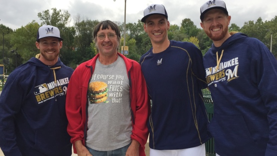 Michael Reed, Brent Suter and Ben Rowen pose with Don Gorske, the Big Mac record holder.